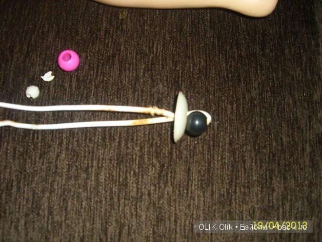 заменяем шарик и одеваем внутреннюю шайбочку которую извлекли из нижней части ноги