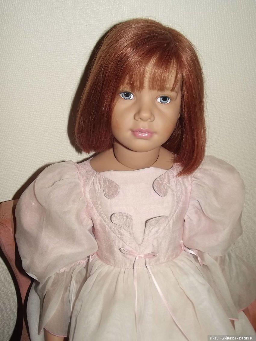 Картинка кукла с бусами старой ингушской