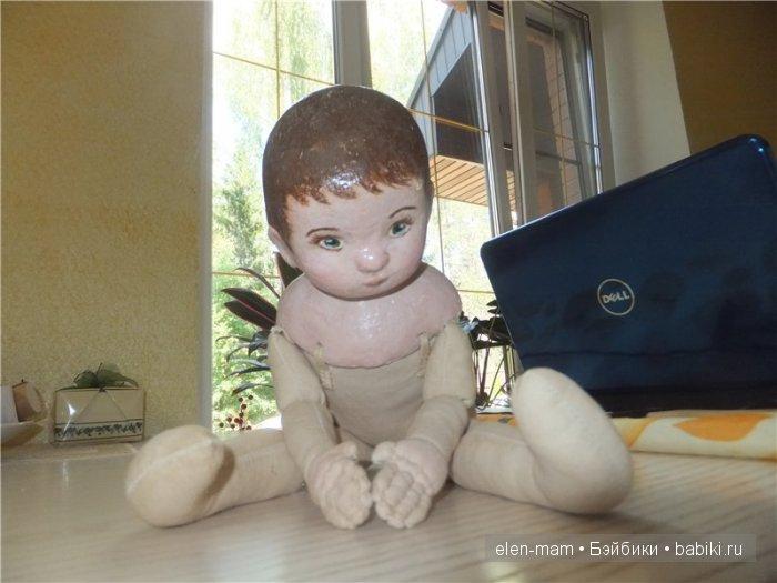 Кукла села