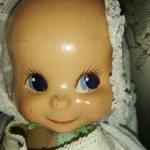 Трехликая антикварная кукла