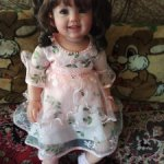 Нарядное розовое платьице