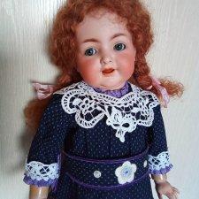 Новая кукла, новое платье