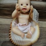Малыш в ракушке