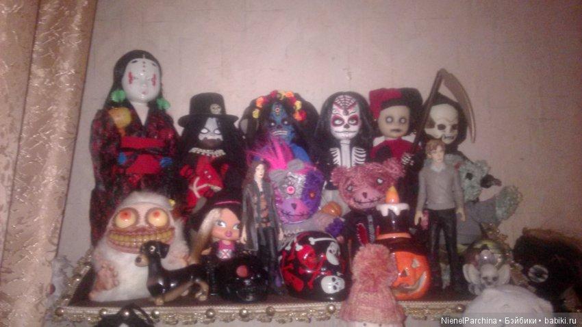 Первая в маске это LAD,остальные Макумба,Сантерия,Каравелла,Джокер и Смерть(голова светится в темноте,тело шоколадное)