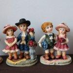 Четыре статуэтки мальчик и девочка