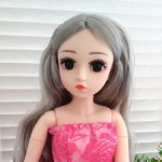 Шарнирная красивая куколка ростом 43 см.