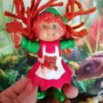 Забавная маленькая куколка