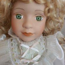 Помогите понять что за кукла материал вроде фарфор