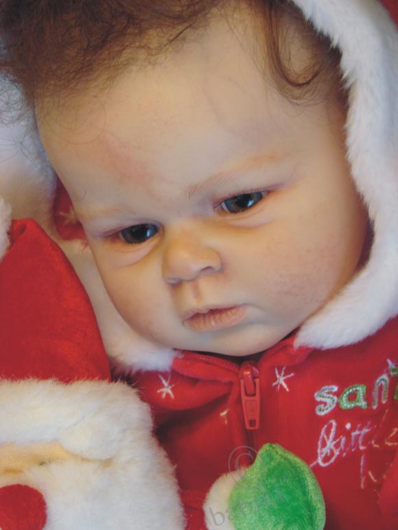 Мая в образе крошечного Санта Клауса. Кукла реборн