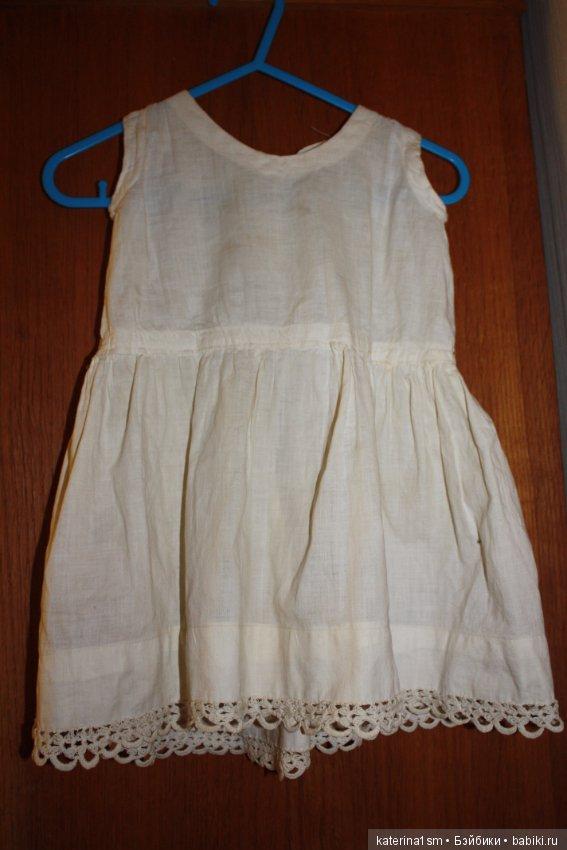239f29ea29e6b58 Вторая рубашка явно перешита из взрослой или детской вещи. Ткань плотная,  хлопок. Нижний край передней стороны не очень удачно собран(смотрите фото).